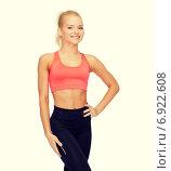 Купить «beautiful athletic woman in sportswear», фото № 6922608, снято 8 мая 2014 г. (c) Syda Productions / Фотобанк Лори