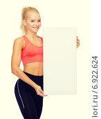 Купить «smiling sportswoman with white blank board», фото № 6922624, снято 8 мая 2014 г. (c) Syda Productions / Фотобанк Лори