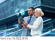 businesspeople with tablet pc outdoors. Стоковое фото, фотограф Syda Productions / Фотобанк Лори