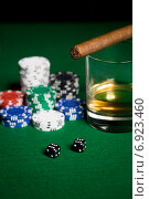 Купить «close up of chips, dice, whisky and cigar on table», фото № 6923460, снято 17 октября 2014 г. (c) Syda Productions / Фотобанк Лори