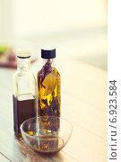 Купить «close up of two olive oil bottles and bowl of oil», фото № 6923584, снято 21 января 2014 г. (c) Syda Productions / Фотобанк Лори