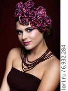 Купить «Beautiful young woman with artificial rouses on head necklace and dress on red marsala color background», фото № 6932284, снято 25 января 2015 г. (c) Serg Zastavkin / Фотобанк Лори