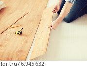 Купить «close up of male hands intalling wood flooring», фото № 6945632, снято 28 января 2014 г. (c) Syda Productions / Фотобанк Лори