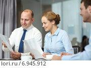 Купить «business people with papers meeting in office», фото № 6945912, снято 25 октября 2014 г. (c) Syda Productions / Фотобанк Лори