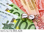 Два кубика на фоне евро и рублей. Стоковое фото, фотограф Сергей Прокопенко / Фотобанк Лори