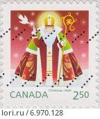 Купить «Рождественский сюжет на почтовой марке Канады», иллюстрация № 6970128 (c) Илюхина Наталья / Фотобанк Лори