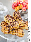 Купить «Eclairs on cake stand. Party dessert», фото № 6976712, снято 15 июля 2019 г. (c) BE&W Photo / Фотобанк Лори