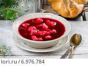 Купить «Beetroot red borsch with polish dumplings uszka. Traditional christmas eve in Poland. Selective focus.», фото № 6976784, снято 27 июня 2019 г. (c) BE&W Photo / Фотобанк Лори