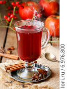 Купить «Mulled wine - a beverage made with red wine along with various mulling spices and raisins.», фото № 6976800, снято 10 января 2019 г. (c) BE&W Photo / Фотобанк Лори