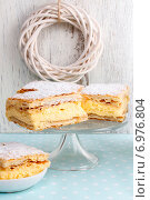 Купить «A Polish cream pie made of two layers of puff pastry, filled with whipped cream. Party dessert», фото № 6976804, снято 16 января 2019 г. (c) BE&W Photo / Фотобанк Лори