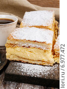 Купить «A Polish cream pie made of two layers of puff pastry, filled with whipped cream.», фото № 6977472, снято 15 августа 2018 г. (c) BE&W Photo / Фотобанк Лори