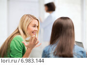 Купить «student girl gossiping in lecture at school», фото № 6983144, снято 16 июня 2013 г. (c) Syda Productions / Фотобанк Лори