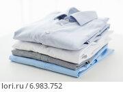 Купить «close up of ironed and folded shirts on table», фото № 6983752, снято 13 ноября 2014 г. (c) Syda Productions / Фотобанк Лори