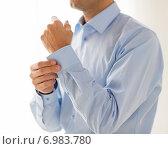 Купить «close up of man fastening buttons on shirt sleeve», фото № 6983780, снято 13 ноября 2014 г. (c) Syda Productions / Фотобанк Лори