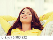 Купить «smiling young woman lying on sofa at home», фото № 6983932, снято 19 марта 2014 г. (c) Syda Productions / Фотобанк Лори