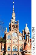 Купить «View of Barcelona. Main facade of Hospital de la Santa Creu i Sant Pau», фото № 6988084, снято 24 февраля 2019 г. (c) Яков Филимонов / Фотобанк Лори
