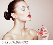 Купить «Young beautiful woman with bottle of perfume. Perfect Makeup», фото № 6998092, снято 1 сентября 2013 г. (c) Ingram Publishing / Фотобанк Лори