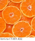 """Фон из нарезанных слоями сочных мандаринов японского сорта """"Сацума"""" (Citrus unshiu) Стоковое фото, фотограф Алексей Копытько / Фотобанк Лори"""