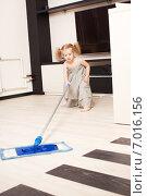 Купить «Girl washes a floor mop», фото № 7016156, снято 24 марта 2013 г. (c) Гладских Татьяна / Фотобанк Лори