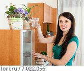 Купить «Smiling woman watering flowers», фото № 7022056, снято 16 августа 2018 г. (c) Яков Филимонов / Фотобанк Лори