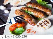 Купить «Жареные колбаски с овощами», фото № 7030336, снято 18 июля 2019 г. (c) Руслан Митин / Фотобанк Лори
