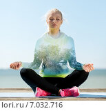 Купить «happy young woman doing yoga outdoors», фото № 7032716, снято 19 июня 2013 г. (c) Syda Productions / Фотобанк Лори