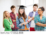 Купить «girl in graduation cap with certificate», фото № 7032808, снято 16 июня 2013 г. (c) Syda Productions / Фотобанк Лори