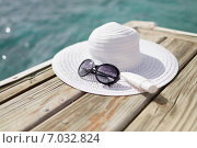 Купить «close up of beach accessories at seaside», фото № 7032824, снято 12 февраля 2014 г. (c) Syda Productions / Фотобанк Лори