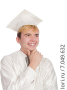 Купить «Young male student graduated from high school on white», фото № 7049632, снято 17 января 2014 г. (c) Elnur / Фотобанк Лори