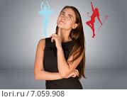 Купить «Девушка мечтает, цветные силуэты ангела и демона, серый фон», фото № 7059908, снято 20 марта 2019 г. (c) Кирилл Черезов / Фотобанк Лори