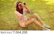 Купить «In high quality 4k format pretty brunette with retro camera », видеоролик № 7064208, снято 17 февраля 2019 г. (c) Wavebreak Media / Фотобанк Лори