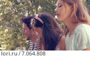Купить «In high quality format happy friends in the park having lunch», видеоролик № 7064808, снято 17 февраля 2019 г. (c) Wavebreak Media / Фотобанк Лори