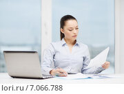 Купить «businesswoman with laptop and charts in office», фото № 7066788, снято 8 декабря 2013 г. (c) Syda Productions / Фотобанк Лори