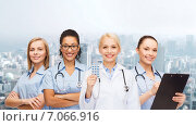 Купить «smiling female doctor and nurses with stethoscope», фото № 7066916, снято 1 декабря 2013 г. (c) Syda Productions / Фотобанк Лори