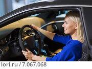 Купить «happy woman inside car in auto show or salon», фото № 7067068, снято 22 января 2015 г. (c) Syda Productions / Фотобанк Лори