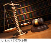 Купить «Justice concept. Gavel, golden scales and books in the library with dof effect.», фото № 7070248, снято 2 июня 2020 г. (c) Maksym Yemelyanov / Фотобанк Лори