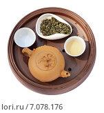 Глиняная чайная посуда и зеленый чай. Стоковое фото, фотограф Ксения Богданова / Фотобанк Лори