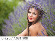 Купить «Beautiful girl in a lavender wreath on a field of lavender.», фото № 7081908, снято 14 июня 2013 г. (c) Александр Савченко / Фотобанк Лори