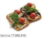 Купить «Два бутерброда со шпротами и зеленью», фото № 7086816, снято 29 января 2015 г. (c) Алексей Маринченко / Фотобанк Лори