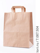 Купить «Бумажный пакет на белом фоне», фото № 7087504, снято 17 апреля 2014 г. (c) Asja Sirova / Фотобанк Лори