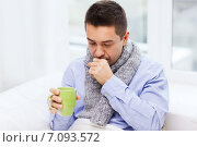 Купить «ill man with flu drinking tea and coughing at home», фото № 7093572, снято 29 января 2015 г. (c) Syda Productions / Фотобанк Лори