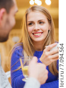 happy couple dating and drinking tea at cafe. Стоковое фото, фотограф Syda Productions / Фотобанк Лори
