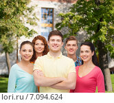 Купить «group of smiling teenagers over campus background», фото № 7094624, снято 22 июня 2014 г. (c) Syda Productions / Фотобанк Лори