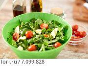 Купить «close up of salad bowl and spices on kitchen table», фото № 7099828, снято 30 апреля 2014 г. (c) Syda Productions / Фотобанк Лори