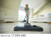 Купить «happy woman with vacuum cleaner at home», фото № 7099940, снято 25 января 2015 г. (c) Syda Productions / Фотобанк Лори