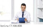 Купить «doctor with tablet pc and clipboard in hospital», видеоролик № 7108808, снято 6 февраля 2015 г. (c) Syda Productions / Фотобанк Лори