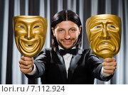 Купить «Funny concept with theatrical mask», фото № 7112924, снято 1 июля 2014 г. (c) Elnur / Фотобанк Лори