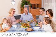 Купить «family sitting at table for dinner», фото № 7125884, снято 13 ноября 2019 г. (c) Яков Филимонов / Фотобанк Лори