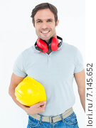 Купить «Happy carpenter with hard hat and ear protectors», фото № 7145652, снято 19 августа 2019 г. (c) Wavebreak Media / Фотобанк Лори