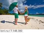 Купить «Couple in green on a beach at Seychelles», фото № 7148380, снято 19 апреля 2014 г. (c) Николай Охитин / Фотобанк Лори
